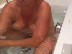 hidden cam unaware MILF in the bath