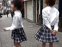 Two Asian twinks in school girls uniform talking about gay sex