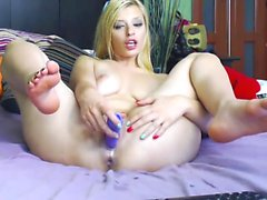 Busty blonde girl driving her shaved pussy to pleasure on t