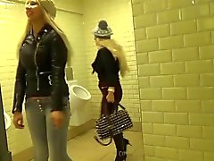 two blondes attack a cock in bathroon