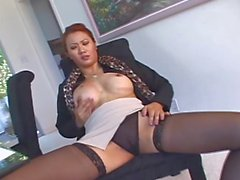Stocking clad Asian with nice nipples on her crazy bolt ons