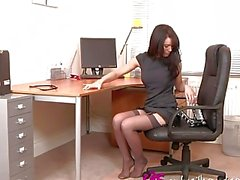 Gorgeous dark haired hottie does a striptease in the office