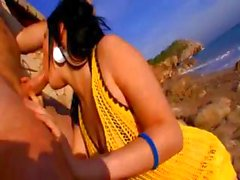 Sexy brunette Sophia Arenas nibbles on a cock at the beach and gets drilled
