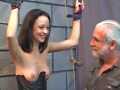 Cute young brunette is excited to have her nipples shocked with electricity