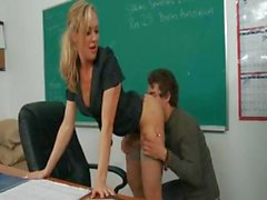Blonde teacher with big tits bangs one of her students in a classroom