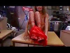 Mature skinny slut wearing red fishnets masturbates on a table