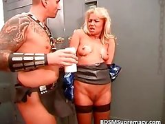 Blond slut in latex gets her boobs hot waxed