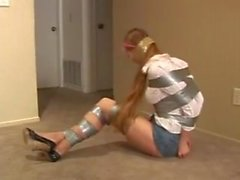 Young girl taped up by old man