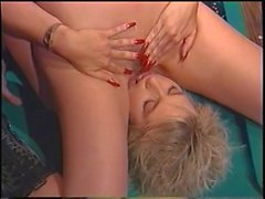 Two sexy babes enjoying a lesbian time as they make on the pool table