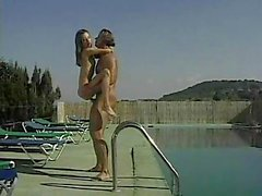 muscle hunk pounding girl by pool