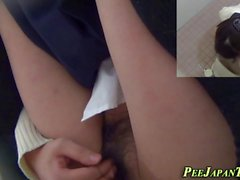 Pissing asian teen rubs