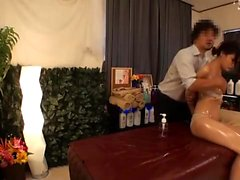Tan naked Japanese milf receives sensual oil massage