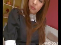 Japanese cutie Ami Kurosawa in a French maid uniform on the floor eating dick