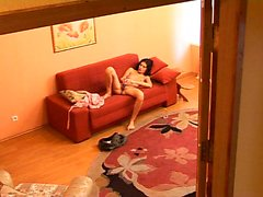 Sweet brunette lies naked on the couch and feeds her lust f