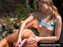 Teens Kate and Tanya toy cunts outdoors