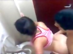 Latina caught fucking in a public restroom