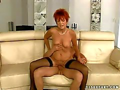 short haired redhead whore in stockings rides on young stud