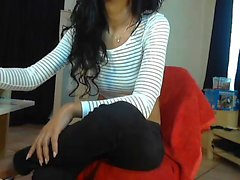 Little brunette gets asked by her webcam audience to finger