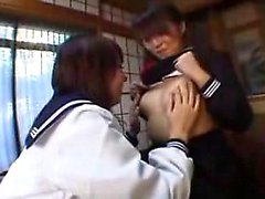 Two delightful Asian girls tonguing and fingering each othe