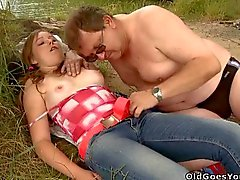 Young sweetheart takes old nasty wang in her mouth