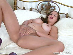 Kinky brunette strips down to nylon pantyhose to fuck toy