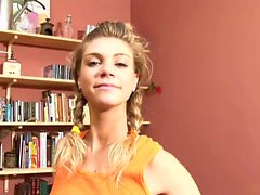 Ally with pigtails plays with her wet vag by the book case