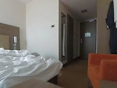 Caught naked in hotel room by maid