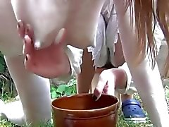 Weird fetish slut milked outdoors