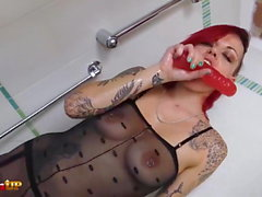 Redhead in a catsuit uses a huge dildo (Onix Babe)