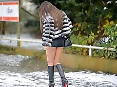 Hooker waiting in louboutin boots in street