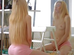 18 year old blonde Erica plays with herself by the mirror