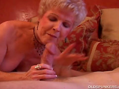 Gorgeous cougar sucks cock and eats cum