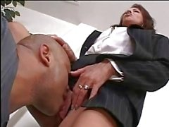 Boss lady evaluates her worker's cock at the office