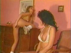 Vintage lesbian action with two babes and a suitcase full of toys