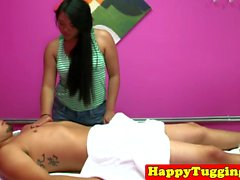 Asian masseuse oils up and slides over client