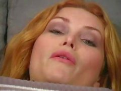 Busty redhead Joi Joe is wearing pantyhose and strips down