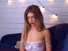 Teen in sexy white lingerie undressing on webcam