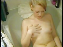 Extremely hot blonde can't stop touching herself
