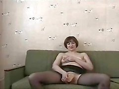 Solo mature dildoing in pantyhose