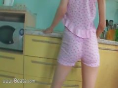 Pussy fingering and toying in kitchen