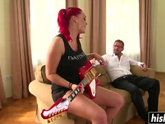 Redhead chick plays with a fat dick