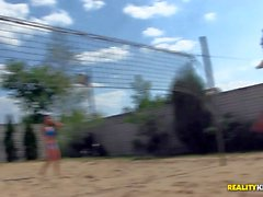 Henessy and Sunny Diamond play volleyball and swim topless