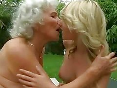 Horny busty granny fucks young blonde