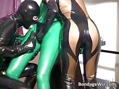 Two horny slut dress in latex and play with dildo with their man