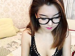 Irresistible young brunette with glasses plays with her har