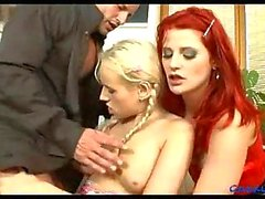 Redhead & blonde in threeway sex
