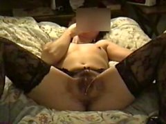Wife in stockings masturbates her hairy pussy