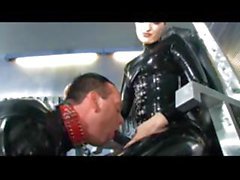Latex babe does some fisting and ass fucks dude with strapon