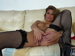 Pretty slim honey in dark nylons Charmane Star fingers her fur pie to climax