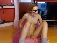 Pigtailed blonde with glasses greases up her body and finge